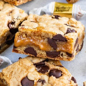 Caramel chocolate chip cookie bars with recipe title on the top of image