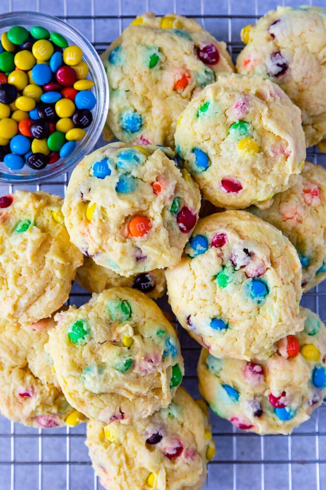 Overhead shot of M&M Cake Mix Cookies next to a bowl of M&Ms