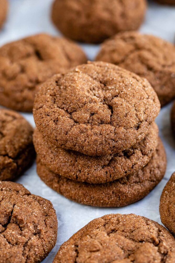 chocolate snickerdoodles stacked on white background