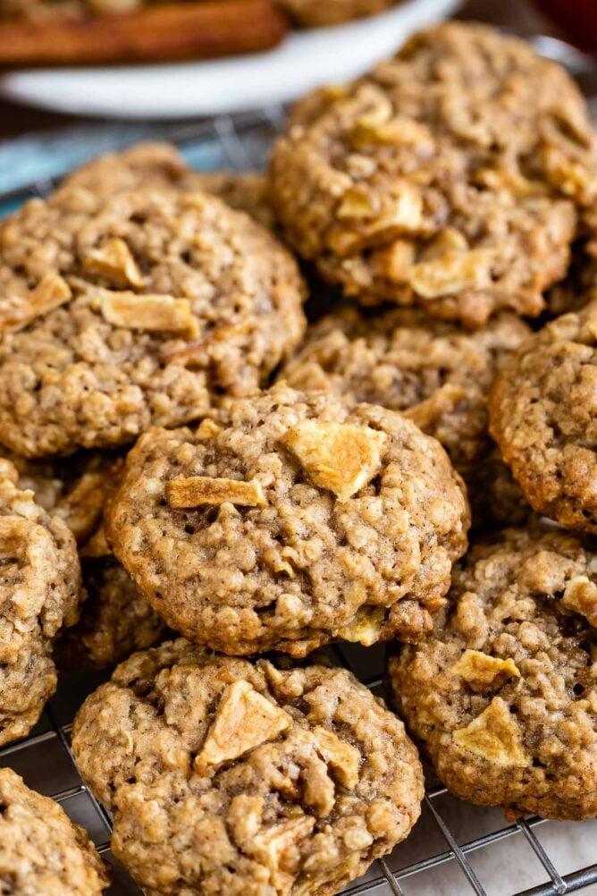 Group of apple oatmeal cookies on a metal cooking rack