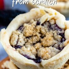 Two mini berry crumb pies stacked on top of eachother with recipe title on top of image