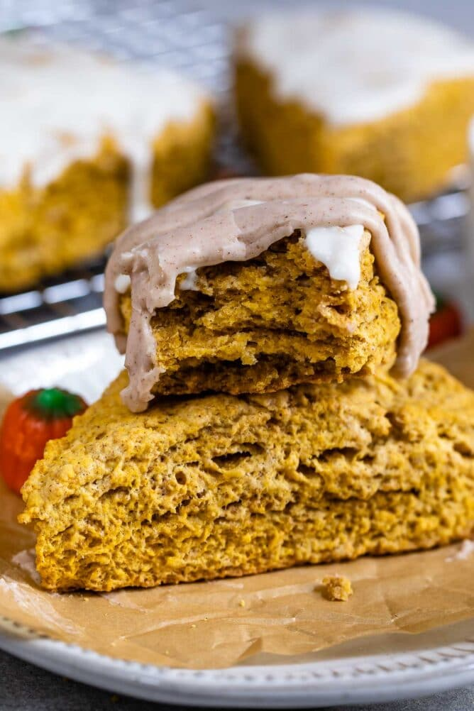 Two pumpkin scones stacked on top of eachother