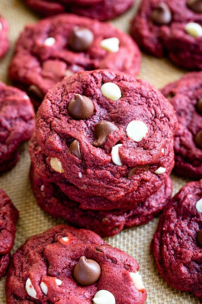 Stack of red velvet cookies with more cookies around it