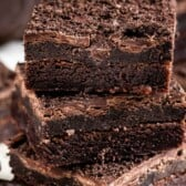 Close up shot of three Oreo truffle brownies stacked on top of eachother