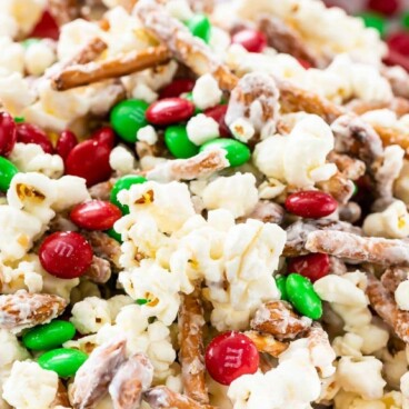 Bowl of santa munch popcorn snack mix with recipe title on top of image